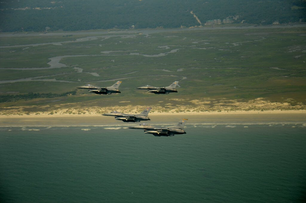 SHAW AIR FORCE BASE, S.C. - Four F-16 Vipers assigned to the 20th Fighter Wing, Shaw Air Force Base, S.C. fly over the South Carolina coast as part of the Salute From the Shore tribute on July 4. Supporters of the U.S. military gather along the carolina coastline on Independence day and illustrate their support by building large flags and signs and cheering when the jets fly above. (U.S.  Air Force photo by  Master Sgt. Cohen A. Young/Released)